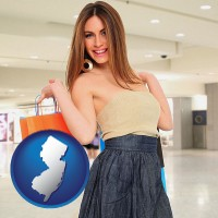 new-jersey map icon and a young woman shopping at the mall