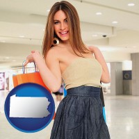 pennsylvania map icon and a young woman shopping at the mall